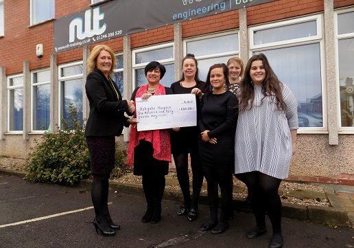 NLT  Chesterfield staff hand over the £650 cheque to Ashgate Hopiscecare representative Lynn Jones